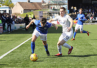 Connor Murray gets away from Ryan Harrington in the SPFL Ladbrokes Championship Play Off semi final match between Queen of the South and Montrose at Palmerston Park, Dumfries on  11.5.19.
