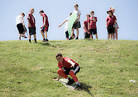 NWA Democrat-Gazette/CHARLIE KAIJO John Moore, 14, of Fayetteville slides down a hill during a tailgate before the game against the Eastern Illinois Panthers, Saturday, September 1, 2018 at Razorback Stadium in Fayetteville.