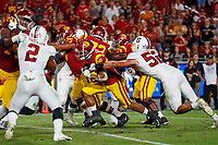 LOS ANGELES, CA - SEPTEMBER 8: USC Trojans running back Vavae Malepeai #29 breaks a tackle attempt from Stanford Cardinal linebacker Casey Toohill #52 and scores a touchdown during a game between USC and Stanford Football at Los Angeles Memorial Coliseum on September 7, 2019 in Los Angeles, California.