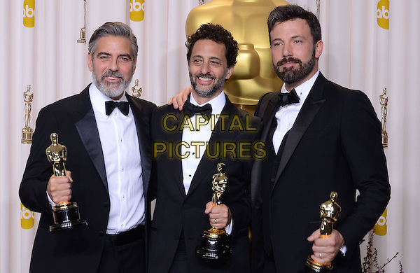 George Clooney, Grant Heslov, Ben Affleck .85th Annual Academy Awards held at the Dolby Theatre at Hollywood & Highland Center, Hollywood, California, USA..February 24th, 2013.pressroom oscars half length black tuxedo bow tie beard facial hair white shirt award trophy trophies winner winners arm over shoulder .CAP/ADM/RE.©Russ Elliot/AdMedia/Capital Pictures.