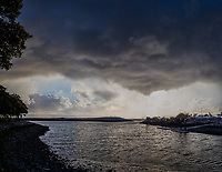 Storm clouds spit rain while stiff winds ripple the water at the San Leandro Marina small boat launch in this panoramic composite.  Ten images combined into a single pano, two up and five across.