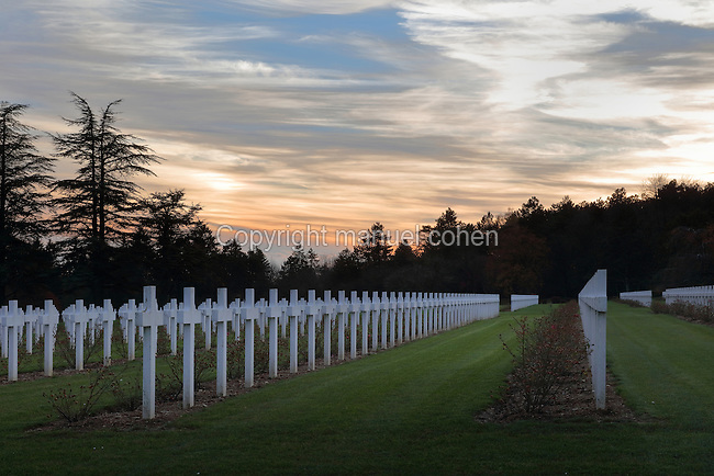The French military cemetery in the evening at the Ossuaire de Douaumont or Douaumont Ossuary, inaugurated 7th August 1932 by French President Albert Lebrun, to house the remains of French and German soldiers who died at the Battle of Verdun in World War One, at Douaumont, Verdun, Meuse, Lorraine, France. The ossuary contains the remains of over 130,000 soldiers and the adjoining military cemetery holds 16,142 graves. This is the largest single French military cemetery of the First World War and was inaugurated in 1923 by Verdun veteran Andre Maginot. It has been listed as a national cemetery. Picture by Manuel Cohen