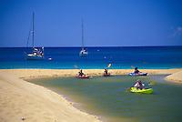 Ocean kayakers explore Waimea bay and river, Island of Oahu