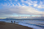 Sufers on Santa Monica Beach with Palos Verdes Peninsula in background