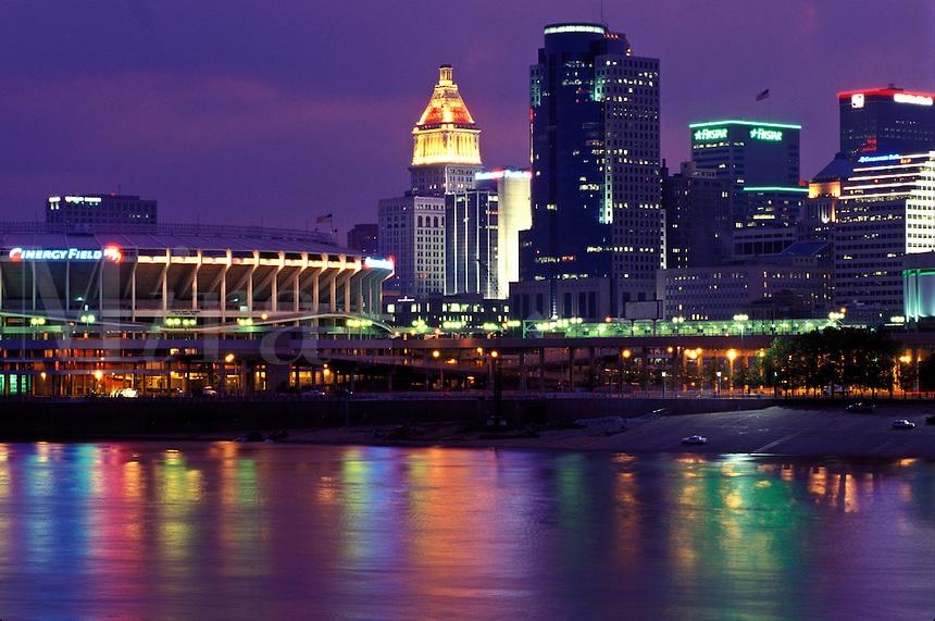 Cincinnati, stadium, skyline, OH, Ohio, Cinergy Field, home of the Cincinnati Reds, and downtown skyline of Cincinnati across the Ohio River in the evening.