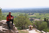 man looking at the view from the ruin chateauneuf du pape rhone france