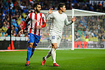 Real Madrid's player James Rodriguez and Sporting de Gijon's player Douglas during match of La Liga between Real Madrid and Sporting de Gijon at Santiago Bernabeu Stadium in Madrid, Spain. November 26, 2016. (ALTERPHOTOS/BorjaB.Hojas)
