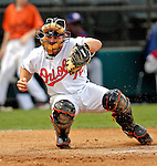 9 March 2007: Baltimore Orioles catcher Ryan Hubele catches warm up pitches between innings against the Washington Nationals at Fort Lauderdale Stadium in Fort Lauderdale, Florida. <br /> <br /> Mandatory Photo Credit: Ed Wolfstein Photo