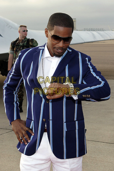 "JAMIE FOXX.World Premiere of Columbia Pictures ""Stealth"".July 17th, 2005.half length blue striped suit jacket sunglasses shades hand on hip looking at watch.www.capitalpictures.com.sales@capitalpictures.com.© Capital Pictures."