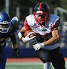 Dion Kuinlan #33 of Plainedge rushes for a gain to get the Red Devils inside Roosevelt's one-yard line during a Nassau County Conference III varsity football game at Roosevelt High School on Saturday, Oct. 13, 2018.