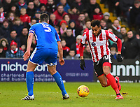 Lincoln City's Matt Green runs at Notts County's Richard Duffy<br /> <br /> Photographer Andrew Vaughan/CameraSport<br /> <br /> The EFL Sky Bet League Two - Lincoln City v Notts County - Saturday 13th January 2018 - Sincil Bank - Lincoln<br /> <br /> World Copyright &copy; 2018 CameraSport. All rights reserved. 43 Linden Ave. Countesthorpe. Leicester. England. LE8 5PG - Tel: +44 (0) 116 277 4147 - admin@camerasport.com - www.camerasport.com