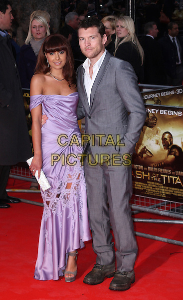 "NATALIE MARK & SAM WORTHINGTON.The ""Clash of The Titans"" world premiere, Empire cinema, Leicester Square, London, England..March 29th, 2010.full length purple off the shoulder silk satin cut out lace open toe platform shoes sandals dress clutch bag grey gray suit white shirt hand in pocket couple lilac .CAP/JIL.©Jill Mayhew/Capital Pictures"