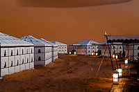 At dusk the porch of each tent is lit with lanterns