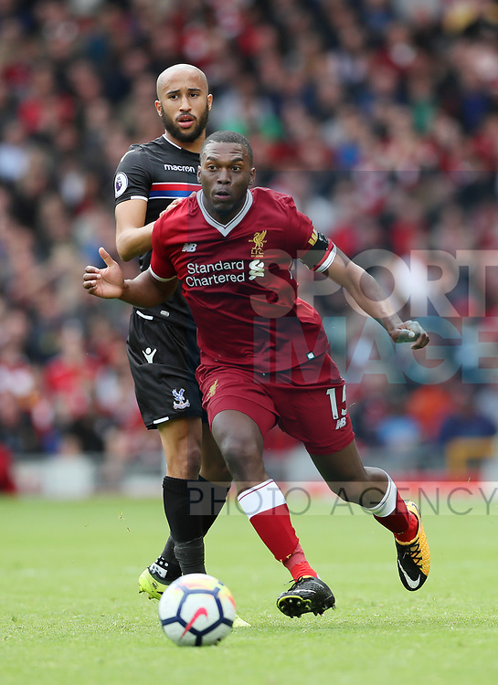 Liverpool's Daniel Sturridge tussles with Crystal Palace's Andros Townsend during the premier league match at the Anfield Stadium, Liverpool. Picture date 19th August 2017. Picture credit should read: David Klein/Sportimage