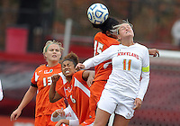 COLLEGE PARK, MD - OCTOBER 28, 2012:   Olivia Wagner (11) of the University of Maryland clashes in the air against Jasmine Paterson (15)of Miami during an ACC  women's tournament 1st. round match at Ludwig Field in College Park, MD. on October 28. Maryland won 2-1 on a golden goal in extra time.