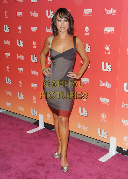 "CHERYL BURKE .at The 2009 US Weekly Annual ""Hot Hollywood"" Party held at My House in Hollywood, California, USA,.April 22nd 2009.                                                                     .full length grey gray Herve Leger dress hands on hips silver peep toe shoes bandage .CAP/DVS.©Debbie VanStory/RockinExposures/Capital Pictures"
