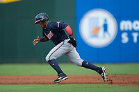 Ronald Acuna (24) of the Gwinnett Braves takes off for second base against the Charlotte Pitmasters at BB&T BallPark on July 15, 2017 in Charlotte, North Carolina.  The Braves defeated the Pitmasters 9-4.  (Brian Westerholt/Four Seam Images)
