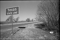 Texas and Oklahoma State Line on the Old Route 66 Road. Plus-X B&W Film Scan
