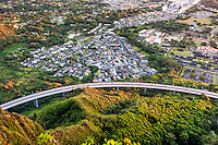 "An aerial view at dawn of Kaneohe ande H-3 Freeway from the Haiku Stairs (""Stairway to Heaven"") hiking trail in Kaneohe, O'ahu"