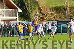 Johnathan Kissane and Mike Breen Beaufort rise over Lieran Doona Laune Rangers during their Mid Kerry semi Final in Beaufort on Saturday