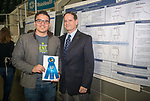 Interim President  Dr. David Descutner (Right) awards Roberto ruiz First place at Ohio University's Student Research and Creative Activity Expo. Photo by Ben Siegel