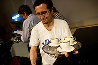 MELBOURNE, AUSTRALIA - JANUARY 09: Volunteer Luca Constanzo collecting competitor's cups at the 2011 Victorian Barista Championship held at St Kilda Town Hall on January 9, 2011 in Melbourne, Australia. (Photo by Sydney Low / Asterisk Images)