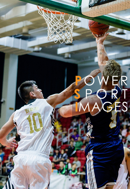 Hosford Ian Daniel #5 of Winling Basketball Club tries to score next to Gonzalez Lau #10 of Eagle Basketball Team during the Hong Kong Basketball League game between Eagle and Winling at Southorn Stadium on May 4, 2018 in Hong Kong. Photo by Yu Chun Christopher Wong / Power Sport Images