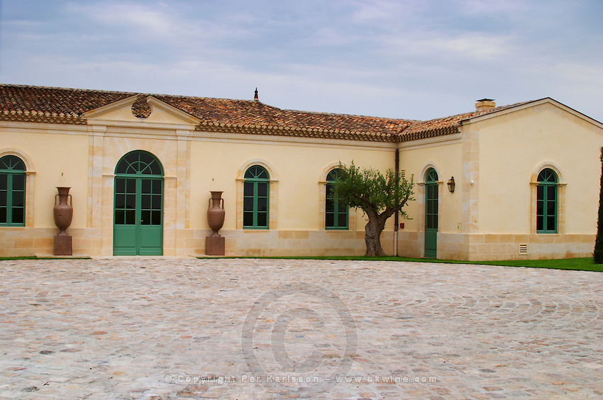 The newly renovated Chateau Petrus, its court yard, urns and olive tree Pomerol Bordeaux Gironde Aquitaine France