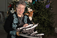 New York, NY, USA - November 14, 2012: OrigamiUSA 2012 Christmas Tree at the American Museum of Natural History. Detail of model decorations. Roz Joyce holds models of a surfeit of skunks.