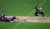 Brendon McCullum tries to run out Yuvrag Singh during 2nd Twenty20 cricket match match between New Zealand Black Caps and West Indies at Westpac Stadium, Wellington, New Zealand on Friday, 27 February 2009. Photo: Dave Lintott / lintottphoto.co.nz