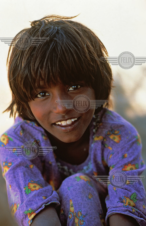 A portrait of a young girl from a rural area.