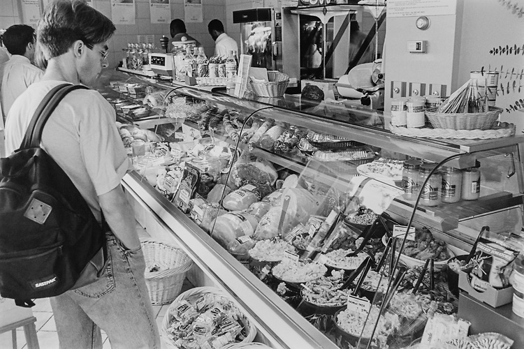 Elmer Eusman surveys his lunch time options at the bread and chocolate deli section, on Aug. 5, 1993. (Photo by Chris Martin/CQ Roll Call via Getty Images)