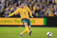 MELBOURNE, AUSTRALIA - OCTOBER 14: Luke Wilkshire from Australia passes the ball in a AFC Asian Cup 2011 match between Australia and Oman at Etihad Stadium on October 14, 2009 in Melbourne, Australia. Photo Sydney Low www.syd-low.com