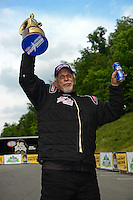 Jun. 17, 2012; Bristol, TN, USA: NHRA pro mod driver Rickie Smith celebrates after winning the Thunder Valley Nationals at Bristol Dragway. Mandatory Credit: Mark J. Rebilas-