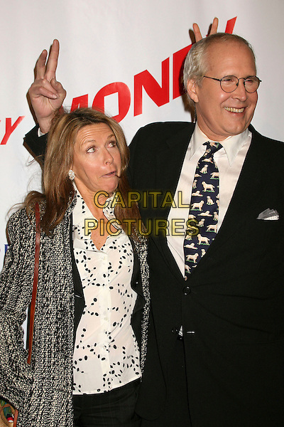 """CHEVY CHASE & wife JAYNIE LUKE.""""Funny Money"""" Los Angeles Premiere at the Directors Guild Theatre, West Hollywood, California , USA,.18 January 2007..half length hand gesture funny pose fingers over head.CAP/ADM/BP.©Byron Purvis/AdMedia/Capital Pictures."""
