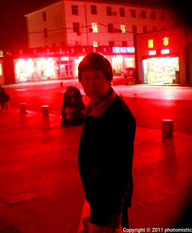 glowing red lady suspicious of the western aliens<br /> Shijiazhuang, Hebei, China