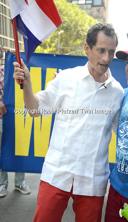 Anthony Weiner marchs in the Dominican Day Parade on Avenue of the Americas in New York City on August 11, 2013.