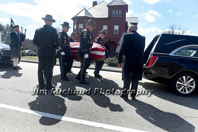 The body of trooper Kevin Miller is carried by his colleagues, Thursday, April 5, 2018, leaving the Introvgne Funeral home in Stafford. (Jim Michaud / Journal Inquirer)