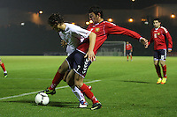 Ferid Matri (left) and Levon Ananyan compete in the Armenia v Switzerland UEFA European Under-19 Championship Qualifying Round match at New Douglas Park, Hamilton on 11.10.12.