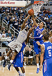 March 3, 2012:   Nevada Wolf Packs Deonte Burton has his shot blocked by Louisiana Tech Bulldogs Michale Kyser during their NCAA basketball game played at Lawlor Events Center on Saturday night in Reno, Nevada.