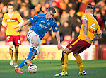 Motherwell v St Johnstone...31.01.15    SPFL<br /> David Wotherspoon takes on Craig Reid<br /> Picture by Graeme Hart.<br /> Copyright Perthshire Picture Agency<br /> Tel: 01738 623350  Mobile: 07990 594431