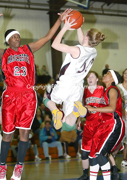GLASTONBURY, CT, 03/06/07- 030607BZ11- Torrington's Michelle Royals (50) goes to the hoop against Manchester's Shanika Hines (23) during the Class LL semifinals at Glastonbury High School Tuesday. <br /> Jamison C. Bazinet Republican-American