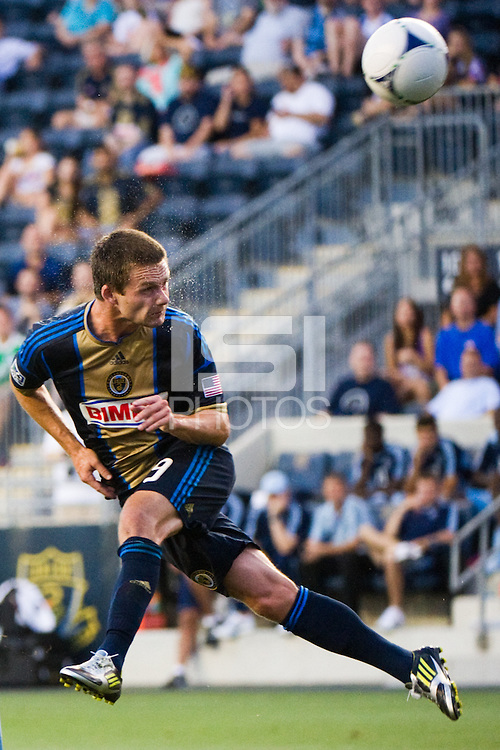 Jack McInerney (9) of the Philadelphia Union heads the ball. Sporting Kansas City defeated the Philadelphia Union 2-0 during the semifinals of the 2012 Lamar Hunt US Open Cup at PPL Park in Chester, PA, on July 11, 2012.