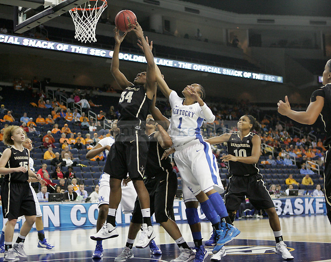 UK guard A'dia Mathies attempts to block a shot by Vanderbilt forward Tiffany Clarke during the first half of the University of Kentucky women's basketball game vs. Vanderbilt University during the SEC tournament The Arena at Gwinnett Center in Duluth, Ga. on Friday, March 8, 2013. UK won 76-65. Photo by Genevieve Adams | Staff