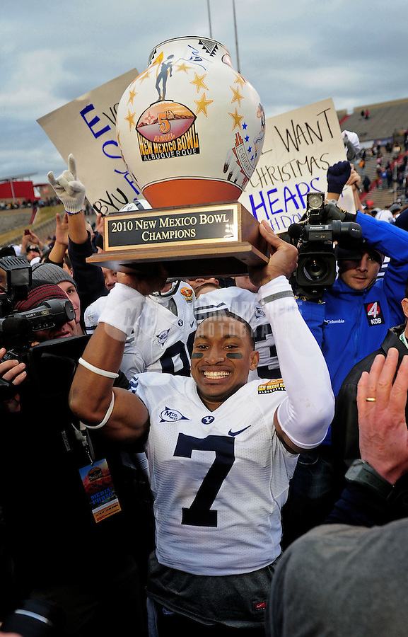 Dec. 18, 2010; Albuquerque, NM, USA; BYU Cougars defensive back (7) Brian Logan lifts the champions trophy following the game against the UTEP Miners in the 2010 New Mexico Bowl at University Stadium. BYU defeated UTEP 52-24. Mandatory Credit: Mark J. Rebilas-