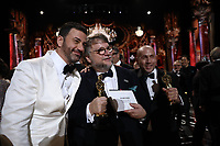 Guillermo del Toro and J. Miles Dale (right) pose with Jimmy Kimmel with the Oscar&reg; for best motion picture for work on &ldquo;The Shape of Water&rdquo; during the live ABC Telecast of the 90th Oscars&reg; at the Dolby&reg; Theatre in Hollywood, CA on Sunday, March 4, 2018.<br /> *Editorial Use Only*<br /> CAP/PLF/AMPAS<br /> Supplied by Capital Pictures