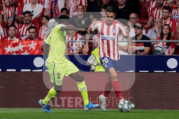 Atletico de Madrid's Victor Machin 'Vitolo' and Getafe CF's Djene Dakoman during La Liga match between Atletico de Madrid and Getafe CF at Wanda Metropolitano Stadium in Madrid, Spain. August 18, 2019. (ALTERPHOTOS/A. Perez Meca)