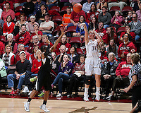 STANFORD, CA - January 27, 2013: Stanford Cardinal's Toni Kokenis making a buzzer beating 3-pt shot during Stanford's 69-56 victory over the Colorado Buffaloes at Maples Pavilion in Stanford, California.