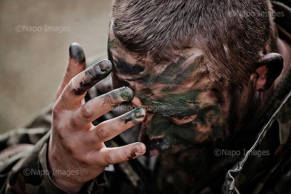 WARSAW, POLAND, 21/02/2015:<br /> Cadets of Polish paramilitary organization FIA (FIDELES ET INSTRUCTI ARMIS) during their training at the Polish army base in Warsaw. FIA consists of ordinary people of various occupations, who volunteer to learn military techniques,  and it's getting more popular because of the war in Ukraine.<br /> Seven such organization including FIA are now being endorsed by the Polish Army, which is planning to create a strong reserve army shaped like the American National Guard.<br /> (Photo by Piotr Malecki)<br /> <br /> WARSZAWA, 21/02/2015:<br /> Czlonkowie paramiliratnej organizacji FIA (Wierni w gotowosci pod bronia) podczas treninigu w jednostce wojsk pancernych w Wesolej. FIA jest jedna z siedmiu orga nizacji, ktore maja przez MON zostac polaczone w federacje i sformowac  nowe sily rezerwowe na wzor amerykanskiej Gwardii Narodowej.<br /> Fot: Piotr Malecki