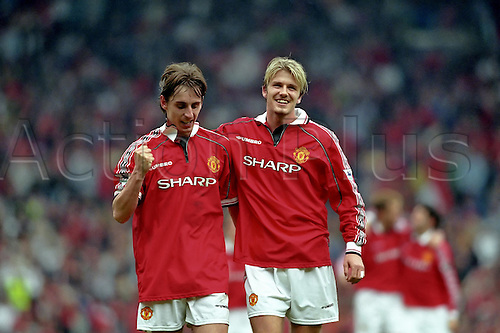 16 May 1999: David Beckham and Gary Neville celebrate United becoming Premier League champions after their match against Tottenham at Old Trafford. Manchester United won the match 2-1. Photo: Glyn Kirk/Actionplus..990516 football soccer player man men celebrate celebration winner